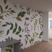 Laminovaná bílá fototapeta se zelenými listy nalepená na stěně interiéru, bílé příčky, puntíkovaný strop, dřevěná podlaha