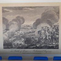 Potištěná fototapeta s motivem historické bitvy vyvedeným v černobílé grafice, nalepená na bílé zdi